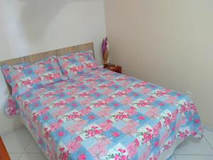 A bed or beds in a room at Conforto Mariner