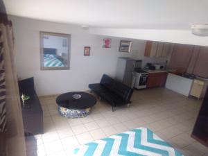 Ein Sitzbereich in der Unterkunft Residence Aito