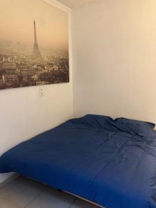 Een bed of bedden in een kamer bij Histoires DODO