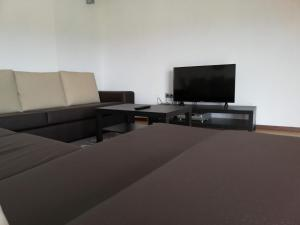 A television and/or entertainment center at Casa de Sermil