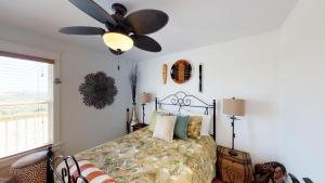Letto o letti in una camera di A Pineapple Paradise Home