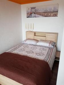 Cama ou camas em um quarto em R&J Apartment