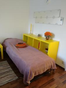 Vuode tai vuoteita majoituspaikassa Scandinavian Sun Apartments
