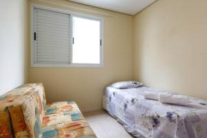 Cama o camas de una habitación en Apartamento na Praia do Novo Campeche - Excelente localização!