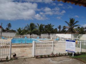 Vista de la piscina de Duplex a beira mar o alrededores
