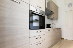A television and/or entertainment center at Sonder — Prati Apartment