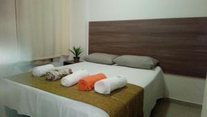 Cama ou camas em um quarto em VG Fun Residence
