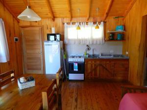 Una cocina o kitchenette en Casita de Madera