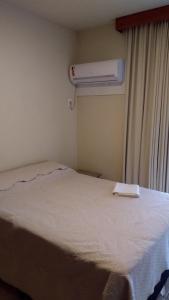 Cama o camas de una habitación en Holiday Ingleses
