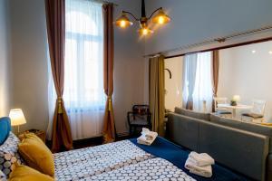 Cama o camas de una habitación en Cluj Aparthotel