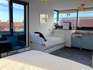 Katil atau katil-katil dalam bilik di HOME Inn Zandvoort
