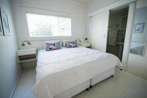 A bed or beds in a room at Leisure By The Sea