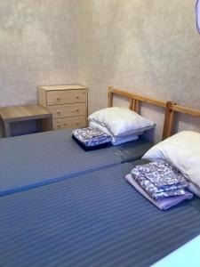 A bed or beds in a room at Apartment Olimpiyskaya 79