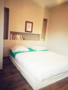 Un ou plusieurs lits dans un hébergement de l'établissement l'Orée du Bois Villa