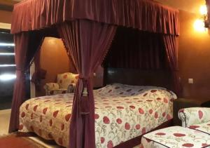 A bed or beds in a room at Marina Agadir