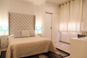 Ein Bett oder Betten in einem Zimmer der Unterkunft Apartamento City