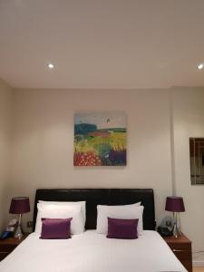 A bed or beds in a room at Grand Plaza Serviced Apartments