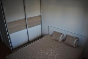 A bed or beds in a room at Apartment Exclusive