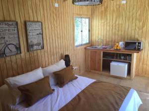 Cama o camas de una habitación en Cabañas Los Sauzales
