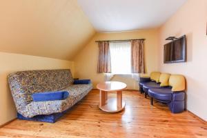 A seating area at Rambyno apartamentai