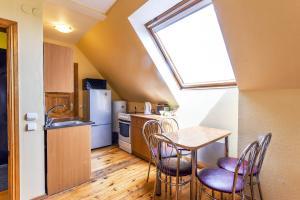 A kitchen or kitchenette at Rambyno apartamentai