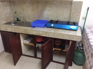 A kitchen or kitchenette at Appartement Centre Ville