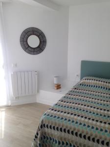 Un ou plusieurs lits dans un hébergement de l'établissement Les Terrasses de la plage de Trestel