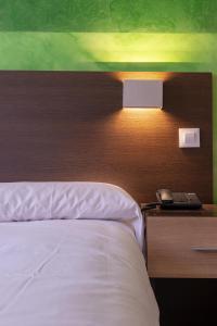 Un ou plusieurs lits dans un hébergement de l'établissement Apart-hotel Serrano Recoletos