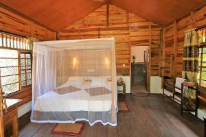 Un ou plusieurs lits dans un hébergement de l'établissement Golden Bay