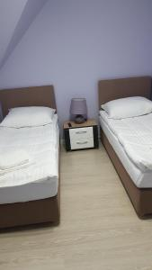 A bed or beds in a room at Apartamenty Białowieża