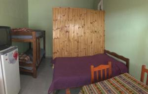 Una cama o camas en una habitación de Tres Abriles