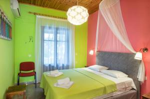 A bed or beds in a room at Helena Apartments & Villas
