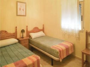 A bed or beds in a room at Four-Bedroom Holiday Home in Navares