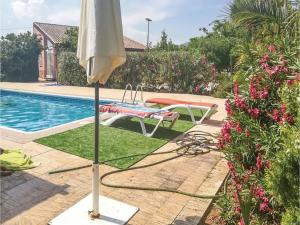 The swimming pool at or near Four-Bedroom Holiday Home in Navares