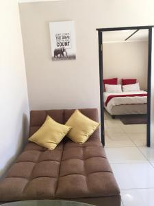 Cama o camas de una habitación en Man Cave Suite
