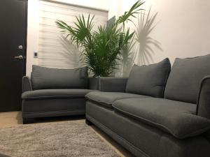 A seating area at Departamento Casa Carlo
