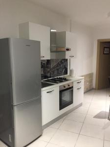 A kitchen or kitchenette at Coppito nel Parco Appartamenti 1