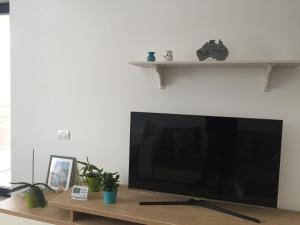 A television and/or entertainment center at Turqoise Home