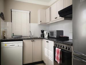 A kitchen or kitchenette at Winelands Golf Lodges