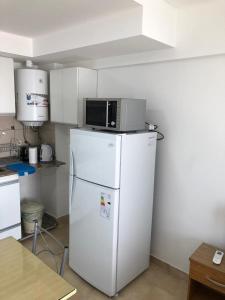 Una cocina o kitchenette en Loft Rosario