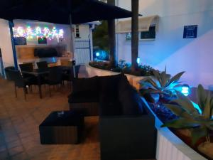 The lounge or bar area at Surfers Beach Resort One