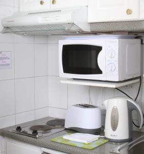 Una cocina o zona de cocina en Apart Hotel Cambiaso