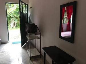 A television and/or entertainment center at HABITACIÓN INDEPENDIENTE CAMINO REAL-