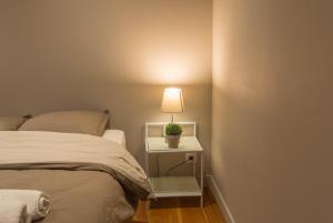 Ein Bett oder Betten in einem Zimmer der Unterkunft The ReisPower - Corovid19 Sales LIMITED