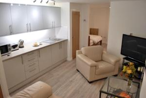 A kitchen or kitchenette at 5B Gallowgate Square Apartments