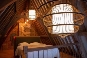 Een bed of bedden in een kamer bij Boutique Logement Londen Centrum Middelburg