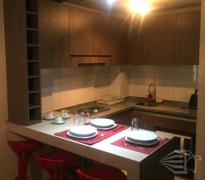 Una cocina o zona de cocina en Tecni Apartments