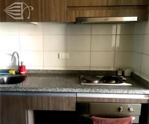 A cozinha ou cozinha compacta de Tecni Apartments
