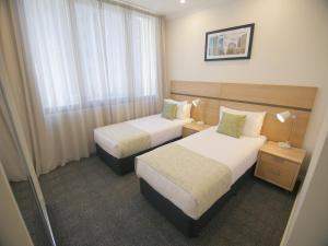 A bed or beds in a room at Quest Adelaide Central