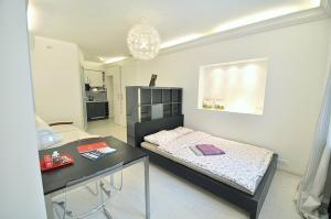 A bed or beds in a room at Flats4U Tverskaya Apartments